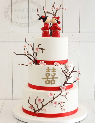 Cherry blossom wedding cake with figurines
