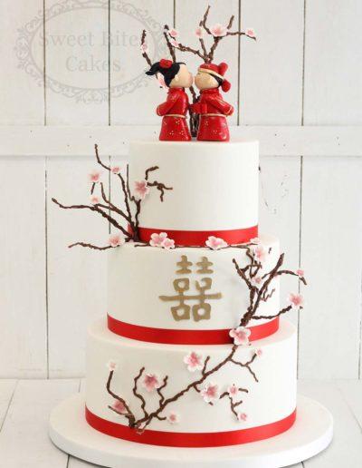 Cherry blossom wedding cake with figurines