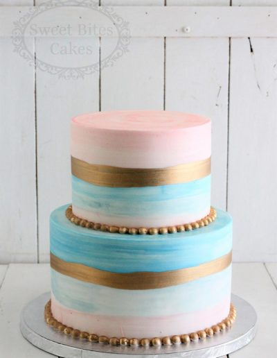 Pastel blue and pink stripe cake