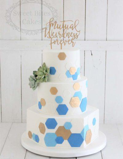 Blue and gold hexagon design wedding cake