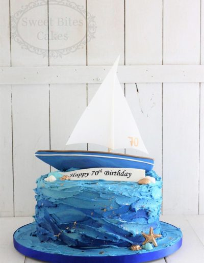 Ocean buttercream cake with boat topper