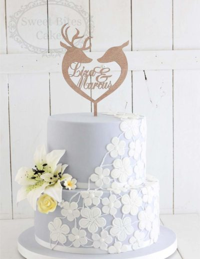 Grey wedding cake with sugar lace and lillies