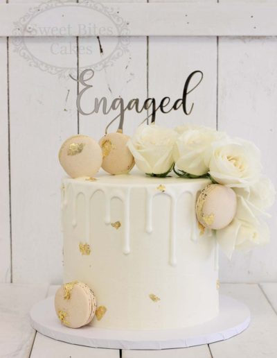 White and gold drip engagement cake