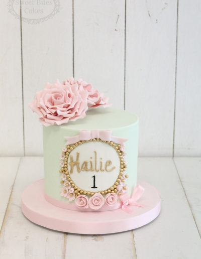 Mint and pink floral cake with gold