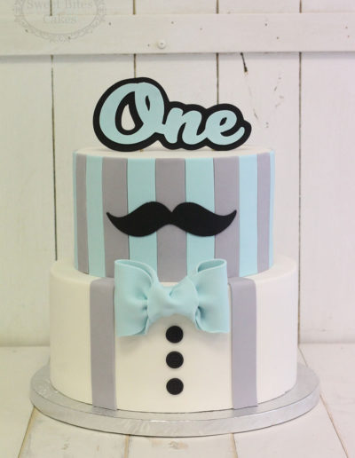 Blue and grey moustache and stripes cake