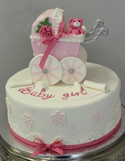 Pink pram baby cake