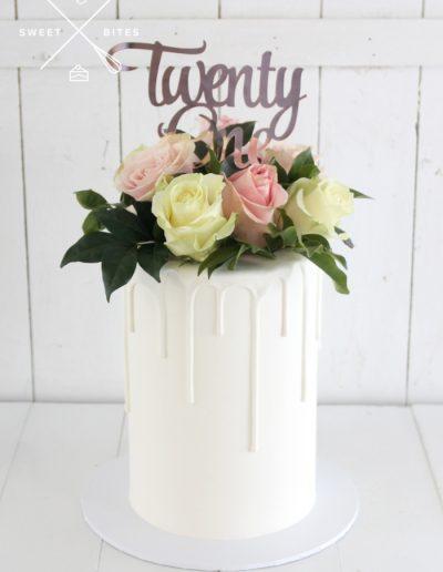 white drip flowers 21st cake