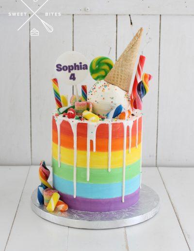 rainbow painted melting icecream candy overload cake