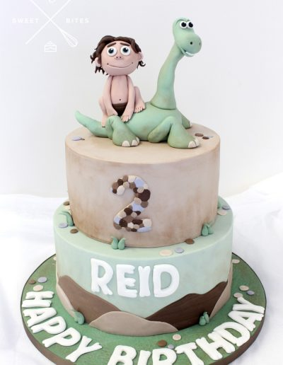 good dinosaur cave man cake 2nd birthday