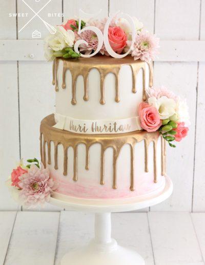 gold drip 50th birthday cake fresh flowers