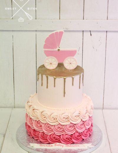 baby shower pink girl pram rosette cake