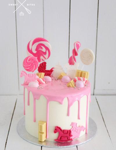 baby shower girl pink drip cake