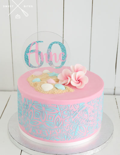pink cake blue tropical stencil frangipanis sand sea shells