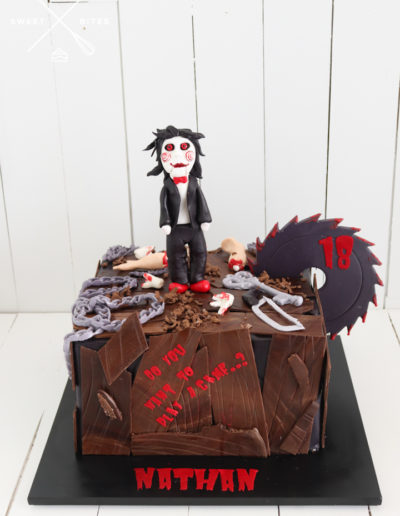 saw cake wood look chains horror billy the puppet
